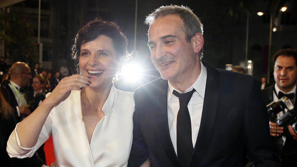 Olivier Assayas junto a Juliette Binoche